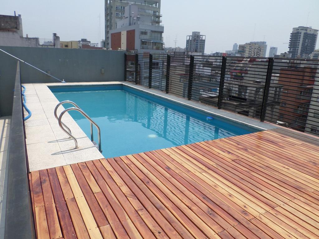 Dos ambietes frente balcón aterrazado cochera fija-Edificio conpileta, solarium, sum,