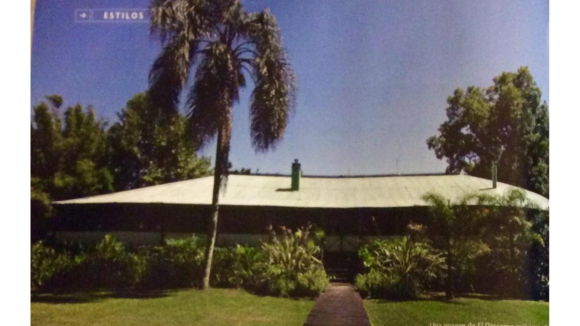 HB BIENES RAICES VENDE Casa de diseño sobre el río chaña Tigre