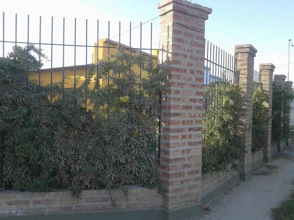 Casa + quincho.