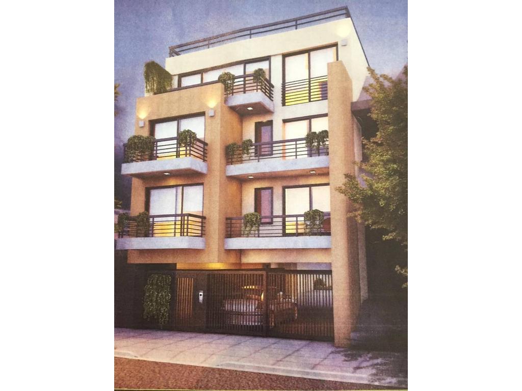 Departamento 2 ambientes contrafrente con balcón, terraza propia, 2 baños y cochera.