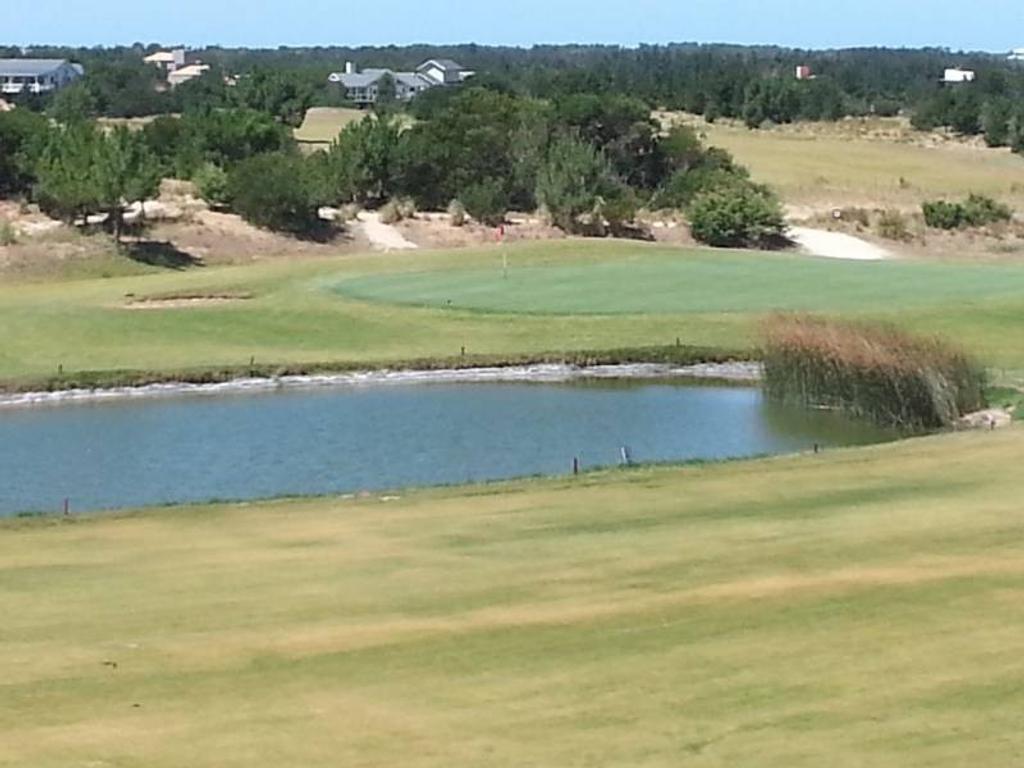 Lote en venta a la laguna, golf 180 H en costa esmeralda