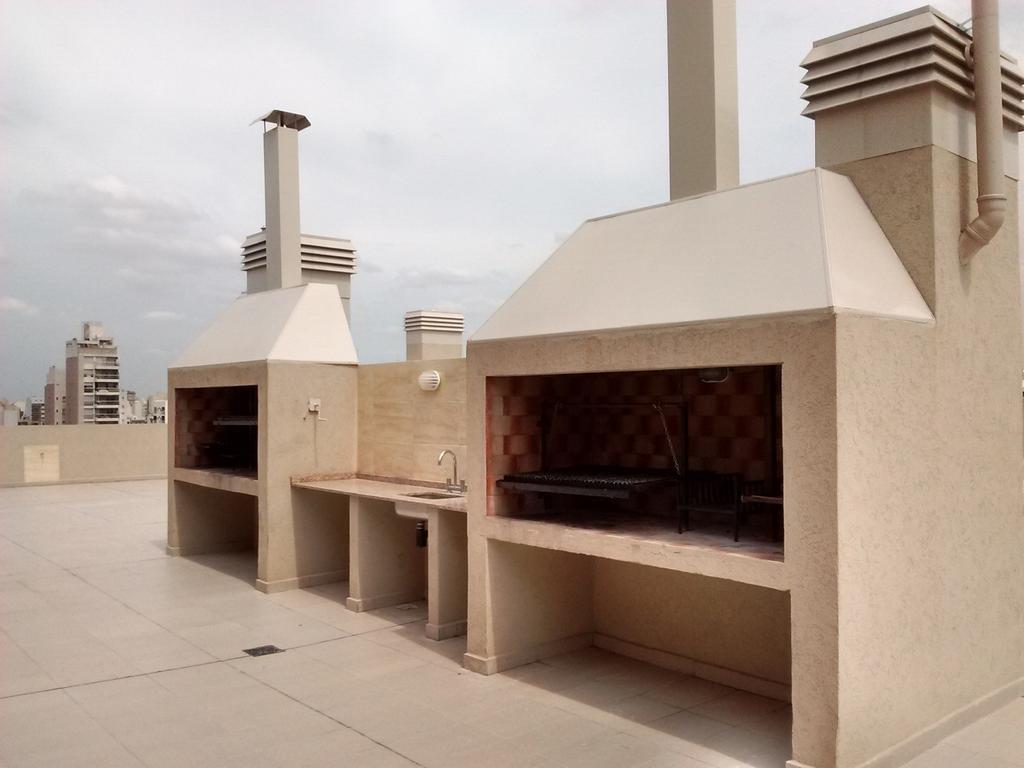 Departamento de 2 ambientes con PATIO de 60 m2 + Cochera opcional - APTO PROFESIONAL - A estrenar