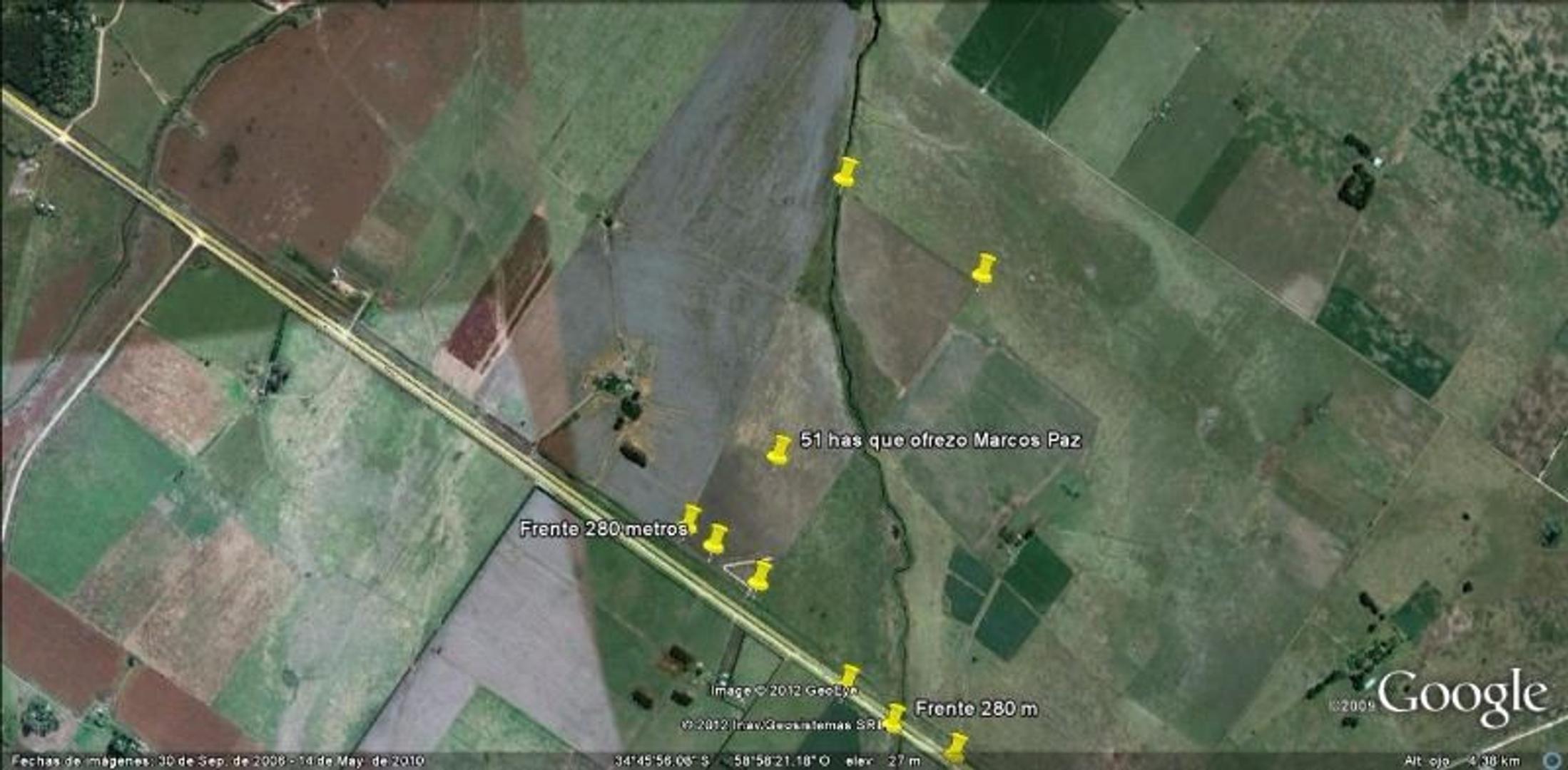 51 Has . Sobre ruta 6 cerca de Plomer , campo mixto sin casa , varios destinos .