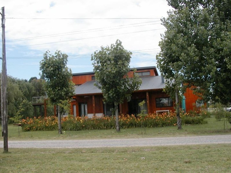Excelente casa en barrio CUBE con vista a laguna