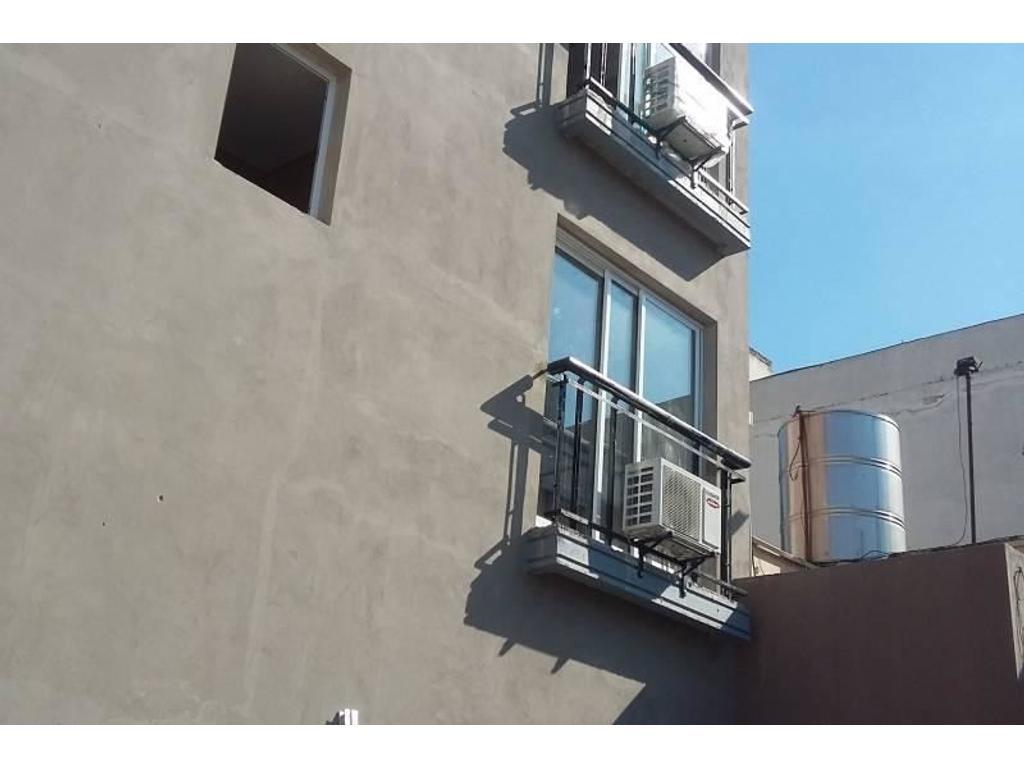 departamento de dos amb al frente con balcon cochera parrilla amenities